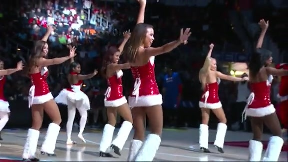 Cheerleaders Dance To Holiday Carols