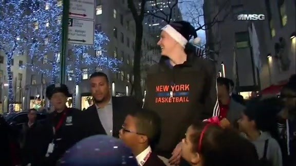 Season of Giving: Kristaps Porzingis Plays Santa At Rockefeller Center