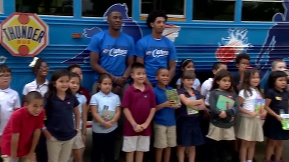 Payne, Christon Bring Smiles With Book Bus