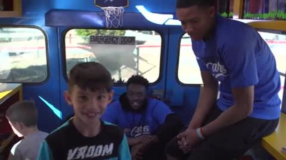 Thunder Duo Inspires Love of Reading With Book Bus