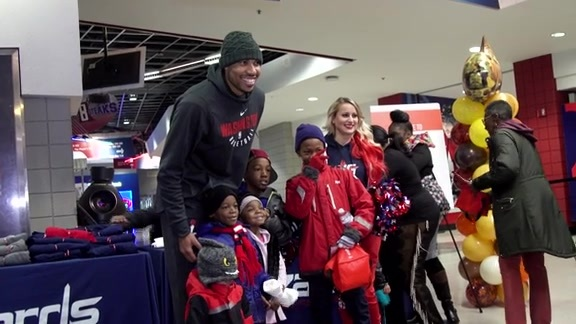 Otto Porter at Wizards Care Thanksgiving Assist