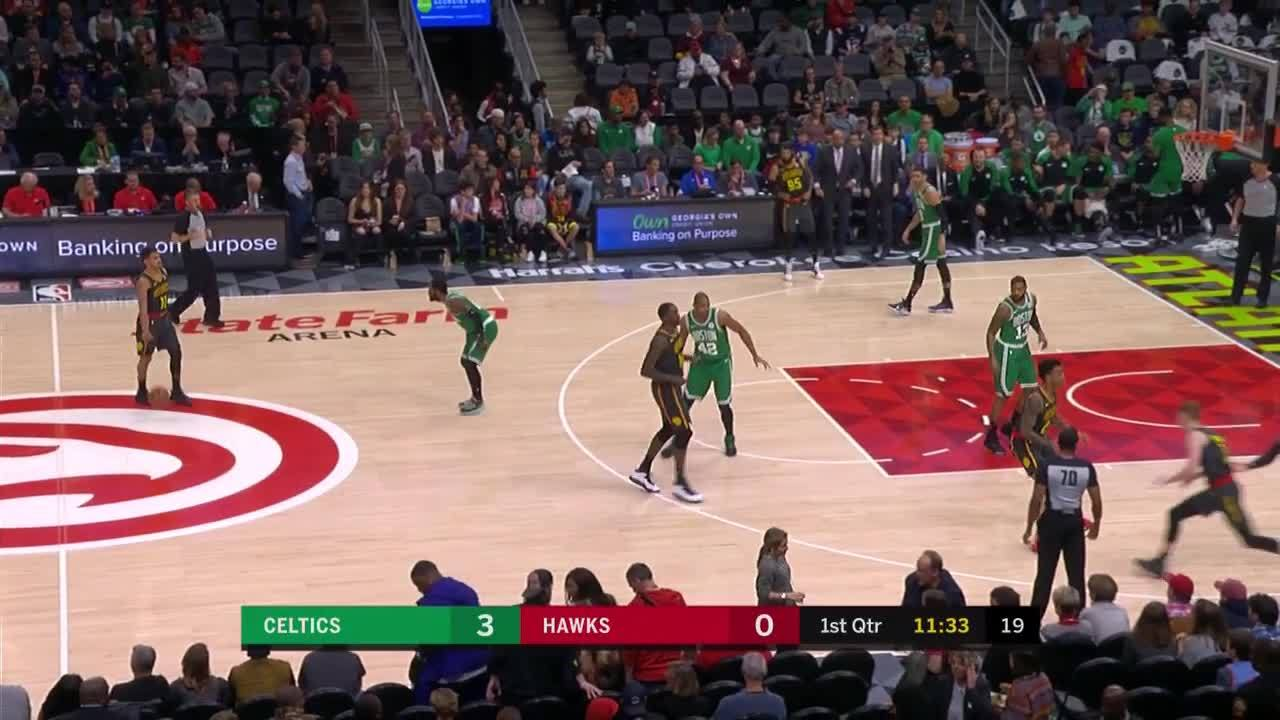 John Collins slams the putback dunk